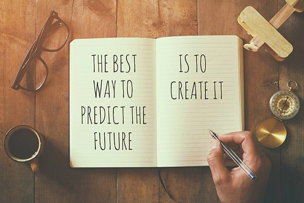 "Notebook with statement ""The best way to predict the future is to create it."""