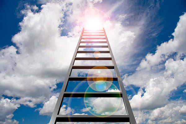Blue sky with clouds and ladder toward sun